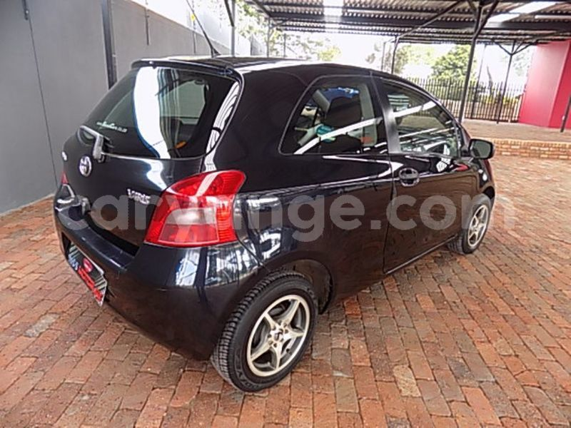 Big with watermark toyota yaris....